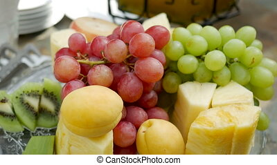 plate of assorted fruits grapes