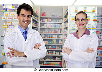 portrait of pharmacists at pharmacy - small business owners:...