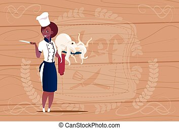 Female African American Chef Cook Holding Octopus Cartoon Chief In Restaurant Uniform Over Wooden Textured Background