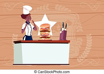 Female African American Chef Cooking Big Burger Cartoon Chief In Restaurant Uniform Over Wooden Textured Background