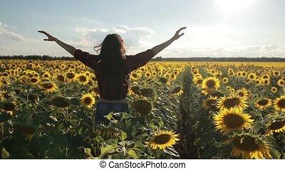 Carefree happy woman running in sunflower field - Joyful...