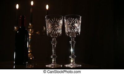 Romantic evening with wine. - Wine glasses on the table, a...
