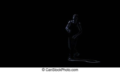 Silhouette man perform brake dance on black background,...