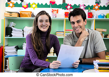 Teacher and parent in classroom - Teachers or teacher and...