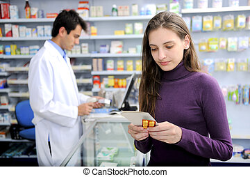 Consumer with medicine at pharmacy - Customer buying...
