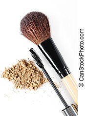 Mascara, beige powder for face and makeup brush on white...