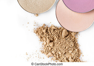 Beige powder for the face and round eye shadow on a white background. Natural make-up.
