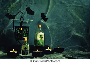 Halloween horror background with a spider's web, candles, potions and bats. Space for your holiday text on Halloween