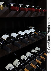 wine bottles in a liquor store - various wine bottles in a...