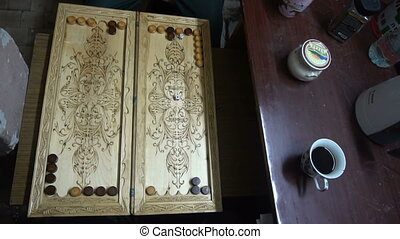 men playing backgammon,wooden Board,roll the dice