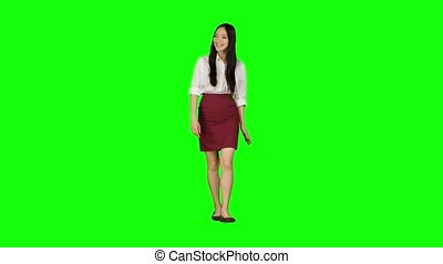 Girl of asian appearance goes to work and waves her hand....