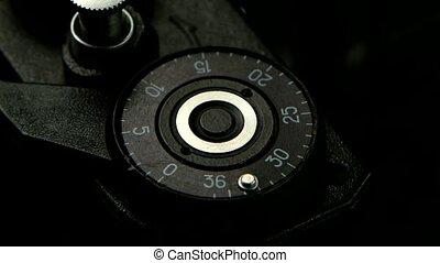 Old camera closeup in detail. Pressing the film rewind...