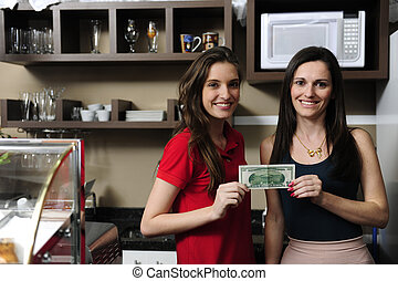 Small business: Owners of a cafe holding cash and smiling