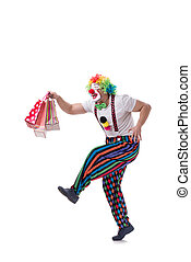 Funny clown with shopping bags isolated on white background