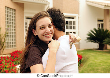 Couple standing outside new house