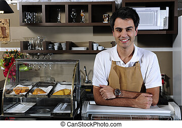 portrait of a waiter at the cafe