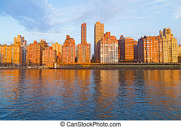 Scenic urban landscape along East River in Manhattan, New...