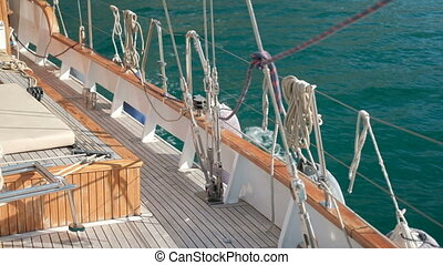 Wooden deck of modern ship or yacht floating on sea. Side of...
