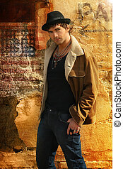 Male Model - Stylish trendy male fashion model against old...