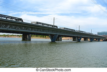 Tempe Railroad - An enclosed railroad bridge spanning Tempe...