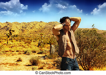 Sexy guy in desert - Fashion portrait of a sexy muscular...