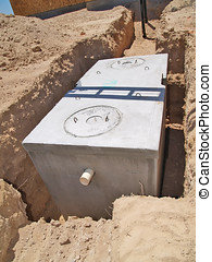 The septic tank has landed - A new septic tank resting in...