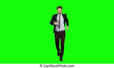 Man is running a telephone rings to him and he talks. Green screen