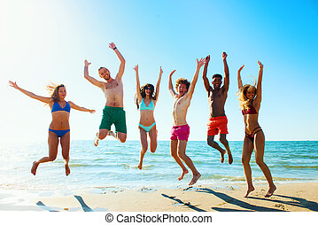 Group of friends having fun on the beach - Happy group of...