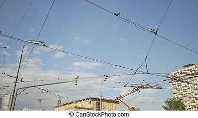 Tramway power line over a blue sky in Moscow city. - Tramway...
