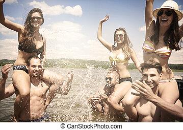 Young people having fun in the lake