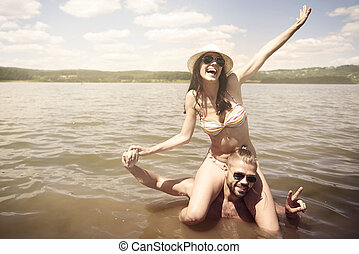 Couple playing in the lake