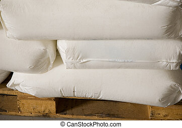 White full bags on a pallet in dry warehouses.