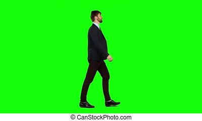Man walks calmly down the street, he is happy. Green screen...