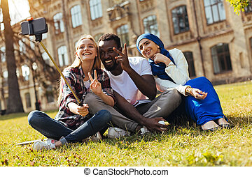 Inspired dynamic young people having amazing time together -...
