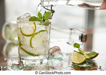 Glass of fresh water with lime