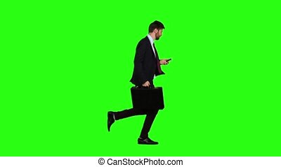 Man is running to work, understands that he is late and begins to run. Green screen. Slow motion