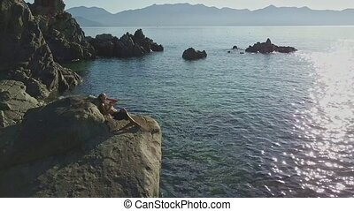 Aerial View Pictorial Azure Ocean with Girl Silhouette on...