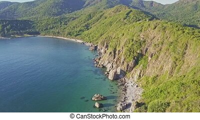 Aerial View Blue Ocean and Green Hilly Rocky Coast - aerial...