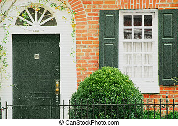 Home - Front door of an upscale brick home (Note: The photo...