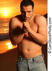 Shirtless man at beach