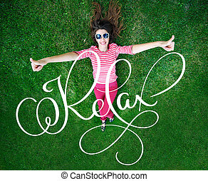 beautiful young woman lying on the green grass in the Meadow...