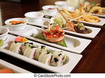 varieties of restaurant food on restaurant table