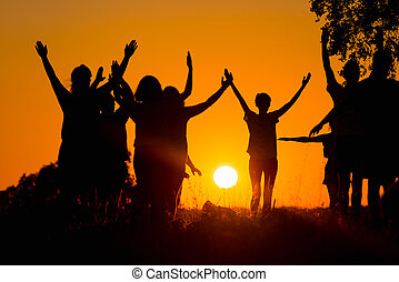 people practicing yoga - Silhouette of several people...