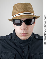 Portrait of Male in Fedora and Sunglasses.