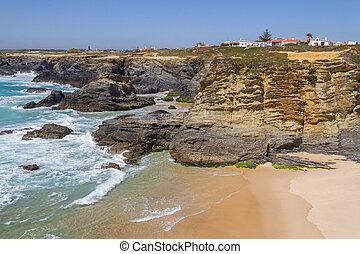 Beach, cliffs and buildings in Porto Covo, Alentejo,...