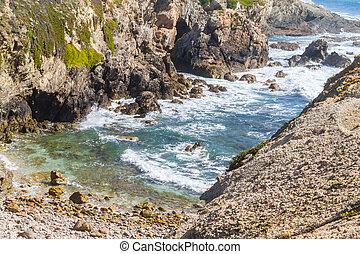 Beach between cliffs in Porto Covo, Alentejo, Portugal