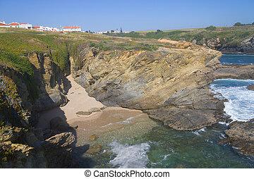 Beach, cliffs and houses in Porto Covo, Alentejo, Portugal