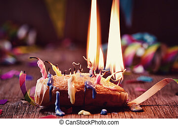blowing out the candles of a cake - a small cake topped with...