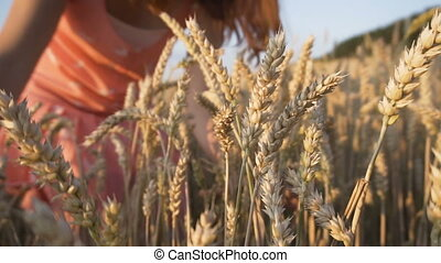 The Wheat Ears - Woman wearing red scirt taking togather...