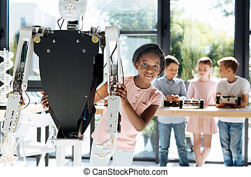 Pretty girl hugging a human robot from behind - Technology...